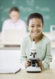 Fototapety Mixed Race girl next to microscope