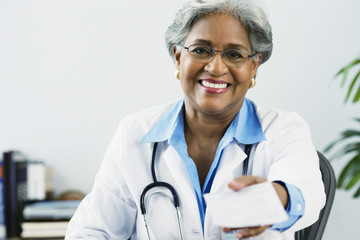 African female doctor holding a prescription