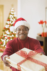 African man holding Christmas gift