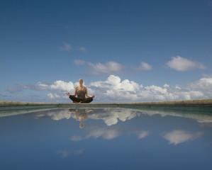Hispanic woman meditating