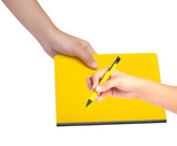 Female hand writing on yellow book poster