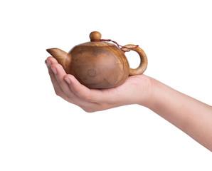 stone teapot on hand
