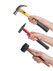 woman's hand holding three hammer on white background