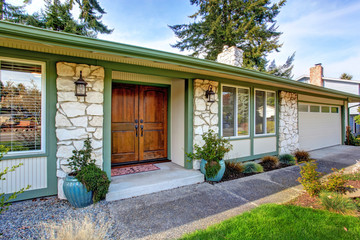 House exterior with stone wall trim