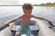 child in an inflatable boat for rowing
