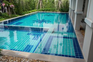 Residential swimming pool in backyard