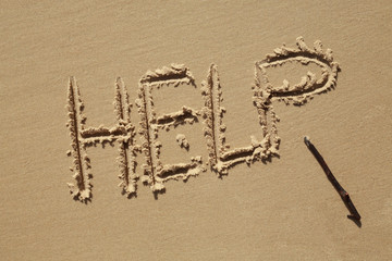 Help Sign on the beach