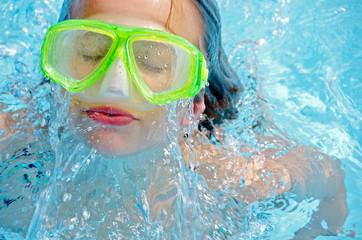 Girl wearing swim goggles