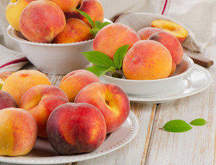 fresh peaches on a wooden table