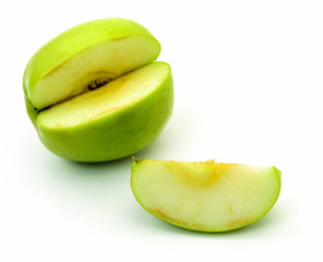 Sliced green apple on white background