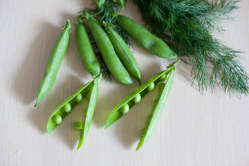 young fresh juicy pods of green peas and fennel