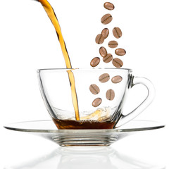 Pour coffee and beans into glass cup.