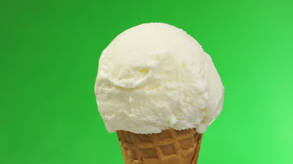 Ice cream in waffles rotates on green screen.