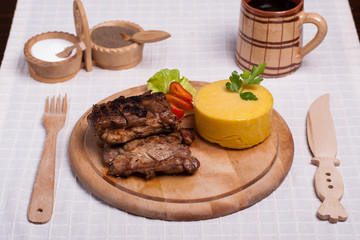 meat with polenta on the wood with re wine