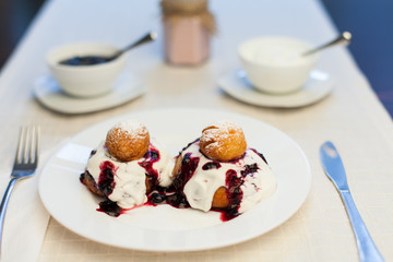 Donuts with jam and cream