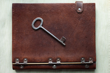Old key on a old book
