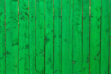 Green wooden vertical planks