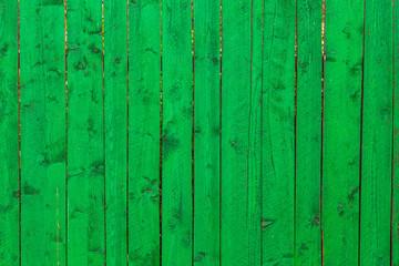 Green wooden vertical planks