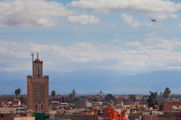 Historical walled city of Marrakesh with ariplane