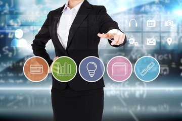 Businesswoman in suit pointing finger to business app buttons
