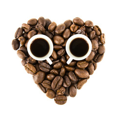 heart from coffee beans and cup isolated on a white background