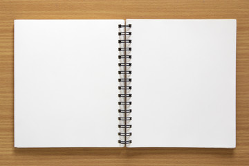 blank spiral notepad on wood background