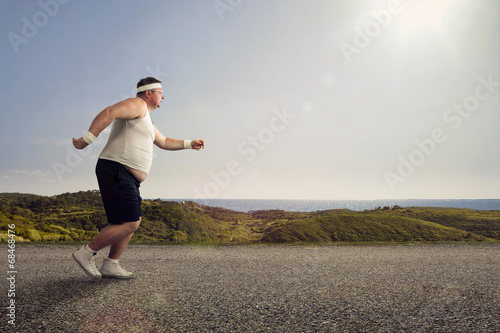 Leinwanddruck Bild Funny overweight man jogging on the road