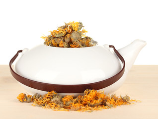 Dried herbs in teapot