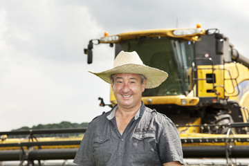 Farmer with combine harvester