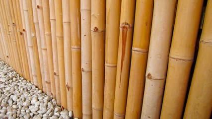 Bamboo fence with stones perspective