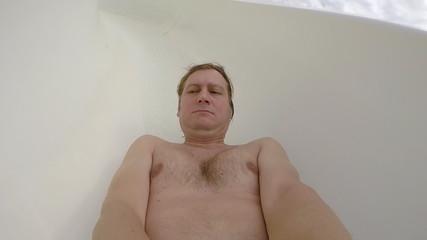 Man on water slide at aqua park