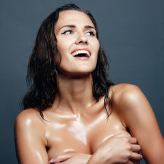 portrait of a beautiful young brunette after a shower