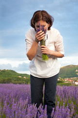 Woman smelling  lavender flowers