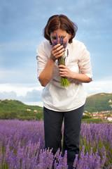 Woman smelling  lavender flowers