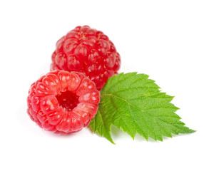 Heap of Two Red Ripe Raspberry with Green Leaf Isolated on White