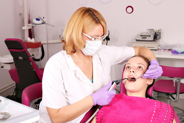 female dentist and girl patient