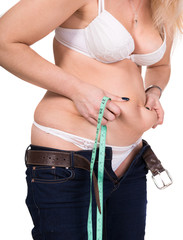 Woman pinching her fat tummy