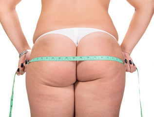 Woman making measure of  hips
