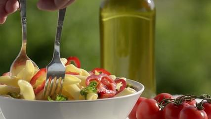 Fresh vegetables and pasta with olive oil