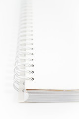 Spiral  white notebook isolated on white background