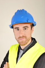 Businessman with construction helmet and reflective vest