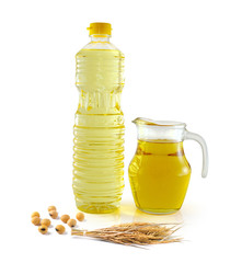 Rice bran oil in bottle glass with rice and soy on white backgro