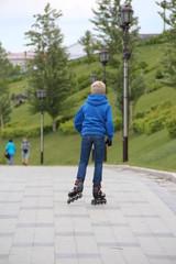 boy riding on roller skates