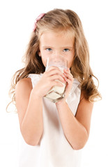 Smiling little girl drinking milk isolated on a white