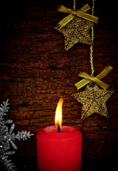 single lit red Christmas candle.