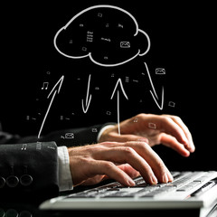 Businessman synchronizing files with the cloud