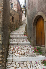 Narrow street of old town Forsa d'Agro. Sicily, Italy
