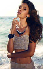 beautiful girl with dark hair in elegant dress with bijou