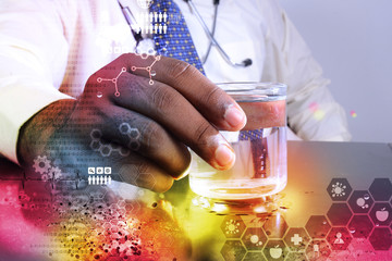 man with stethoscope showing a glass of water