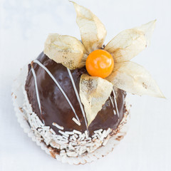 Closeup of cake with physalis
